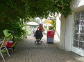 Mother with a baby carriage at The Rotunda Cafe, Preston Park, Brighton, JUL 2011