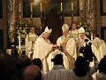 Bishop Daily imposing hands on bishop Caggiano