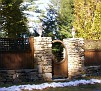 wooden fence and stone walls - beautiful fence