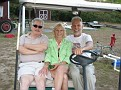 Anita, Ed and I on my golf cart back at the Farm field.